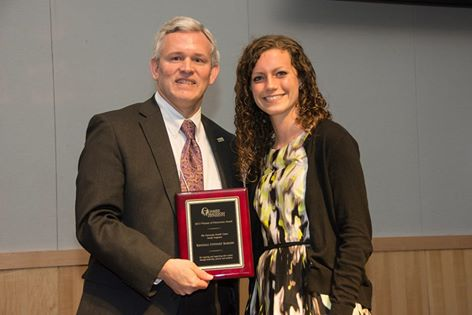 President Alger presenting Kendall Barger with the Woman of Distiction Award